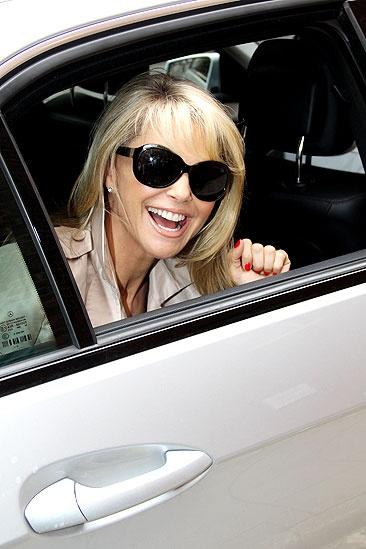 Christie Brinkley Does Chicago in London – Christie Brinkley (car window)