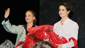 During the curtain call, the ladies are overwhelmed by the ovation.