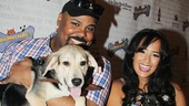 Aladdin co-stars James Monroe Iglehart and Courtney Reed get some puppy love.