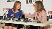 Co-stars LuPone and Winger make each other laugh with their respective responses.