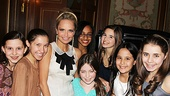 """The next generation of Broadway stars surrounds Kristin Chenoweth before singing """"My New Philosophy"""" for the delighted honoree."""