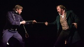 Haydee Tee as Javert and John Owen-Jones as Valjean in Les Miserables. Photo by Matthew Murphy
