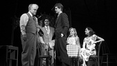 Philip Seymour Hoffman as Willy Loman, Andrew Garfield as Biff Loman, Finn Wittrock as Happy Loman, Elizabeth Morton as Letta and Stephanie Janssen as Miss Forsythe in Death of a Salesman.