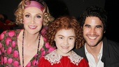 Annie star Lilla Crawford finds herself flanked by Glee standouts Jane Lynch and Darren Criss.