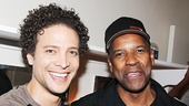 Justin Guarini, who plays Paris in Romeo and Juliet, shares a laugh with Denzel Washington after the performance.