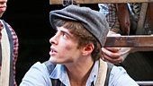 Corey Cott as Jack Kelly and the cast of Newsies. Photo by Heidi Gutman