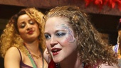 Caroline Neff as Krista and the cast of Airline Highway
