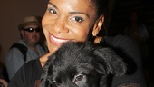 Six-time Tony-winning Lady Day star Audra McDonald cuddles with a sweet puppy.